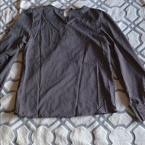 Dotted black and white blouse in long sleeves